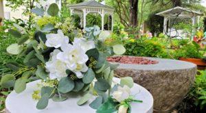 Silk wedding bouquet in blooming garden.