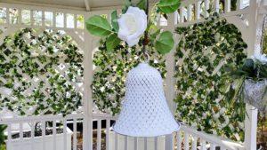 white wedding bell in gazebo