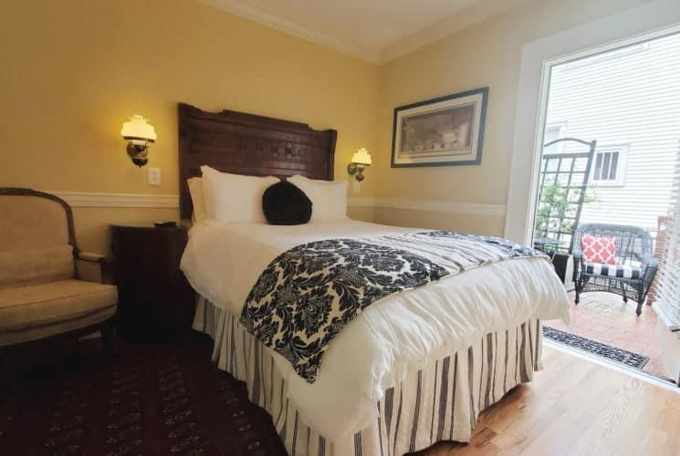 Queen bed with quality linen and open patio door.