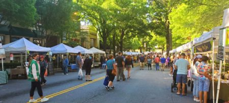 Shaded out door market with people on Main Street